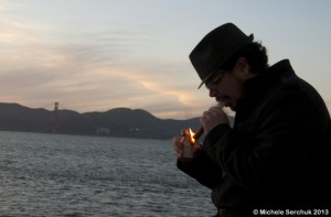 Gray lighting a cigar near the San Francisco Bay