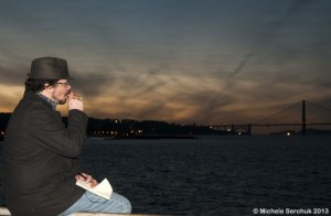 Gray writing while watching the San Francisco bay at sunset and smoking a cigar